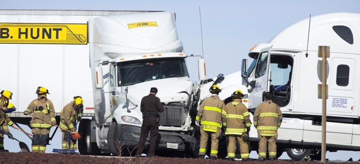 This image shows a collision between two semi-trucks.