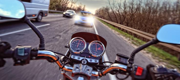 This image shows a motorcycle about to collide head on with a car.