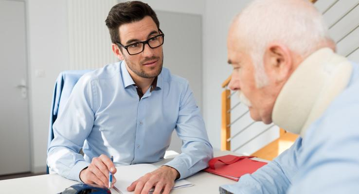 This image shows an elderly man speaking with a Springdale personal injury lawyer.